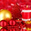 Stock Photo: Red candle with christmas decoration on bright background