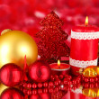 Red candle with christmas decoration on bright background — Stock Photo #18274655