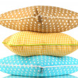Blue, brown and yellow bright pillows isolated on white — Stock Photo