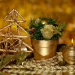 Christmas composition  with candles and decorations in gold color on bright background — Stock Photo