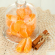 Tangerine on saucer under glass cover on light background — Stock Photo #18275829