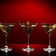 Martini glasses on dark background — Stock Photo