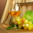 Composition of frame,wine and grapes on bright background — Stock Photo #18276893