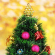 Decorated artificial Christmas Tree on bright background — Stock Photo