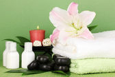 Beautiful spa setting on green background — Stock Photo