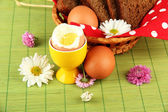 Boiled eggs on color background — Stock Photo