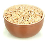 Brown bowl full of oat flakes isolated on white — Stock Photo