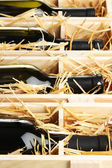 деревянный ящик с бутылки вина крупным планом — Стоковое фото
