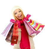 Mulher jovem atraente com muitos sacos de compras, isolado no branco — Foto Stock