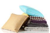Mantas e almofadas de cor, isoladas no branco — Foto Stock