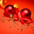 Beautiful bright Christmas balls on red background — Stock Photo