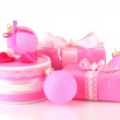 Colorful pink gifts with pink Christmas balls isolated on white — Stock Photo