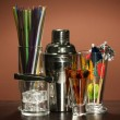 Cocktail shaker and  other bartender equipment on color background - Stock Photo