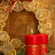 Two candles and christmas decorations, on golden background — Stock Photo #18293651