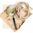 Old paper with magnifying glass and rope isolated on white — Stock Photo