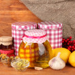 Honey and others natural medicine for winter flue, on wooden background — Stock Photo #18293855