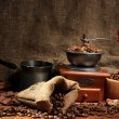 Coffee grinder, turk and cup of coffee on burlap background — Stock Photo #18294215