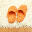 Bright slippers, on floor background — Stock Photo