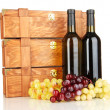 Wooden cases with wine bottles isolated on white — Stock Photo