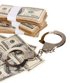 Handcuffs and packs of dollars on white background close-up — Stock Photo