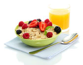 Tasty oatmeal with berries and glass of juice, isolated on white — Stock Photo