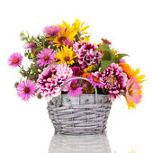 Beautiful bouquet of bright flowers in basket isolated on white — Photo