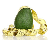 Avocado with measuring tape isolated on white — Stock Photo