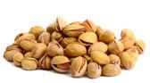 Tasty pistachio nuts, isolated on white — Stock Photo