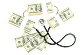 Healthcare cost concept: stethoscope and dollars isolated on white — Stock Photo