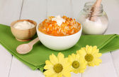 Useful pumpkin porridge in white plate on wooden table close-up — Stock Photo