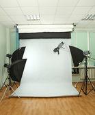 Empty photo studio with lighting equipment — Stock Photo