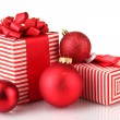 Colorful red gifts with Christmas balls isolated on white — Stock Photo