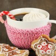 Cup of coffee with Christmas sweetness on wooden table close-up — Stock Photo #18307637