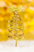 Wire Christmas tree on bright background — Stock Photo