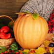 Excellent autumn still life with pumpkin on wooden table on wooden background — Stock Photo