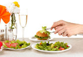 Female hand with dinner isolated on white — Stock Photo
