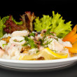 Stock Photo: Delicatessen seafood salad with rice isolated on black