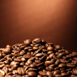 Stock Photo: Coffee beans on brown background