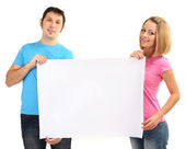 Young couple holding blank poster isolated on white — Stock Photo