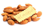 Tasty almonds nuts, isolated on white — Stock Photo