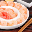 Prawns on plate with chopsticks and sauce — Stock Photo