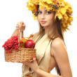 Royalty-Free Stock Photo: Beautiful woman with wreath and basket with apples and berries, isolated on white