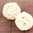 Wicker bamboo balls on bamboo mat - Foto de Stock