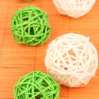 Wicker bamboo balls on bamboo mat - Stok fotoğraf