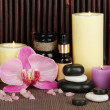 Beautiful spa setting on bamboo background - Stock Photo