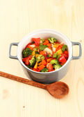 Vegetable stew in gray pot on wooden background — Stock Photo