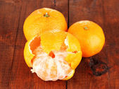 Tasty mandarines on wooden background — Stock Photo