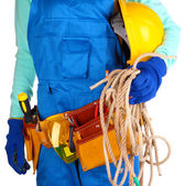 Male builder in blue overalls with rope and helmet isolated on white — Stock Photo
