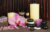 Beautiful spa setting on bamboo background — Stock Photo