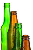 Colorful empty glass bottles isolated on white — Stock Photo